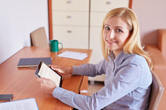 Updating her calendar online Royalty Free Stock Images