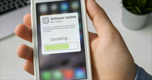 Updating smartphone system software stock footage