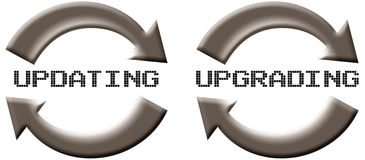 Updating Upgrading. Two icons for software update or upgrade Royalty Free Stock Photo