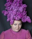 Updo des fleurs lilas Photo stock