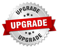 Upgrade 3d silver badge. With red ribbon Royalty Free Stock Images