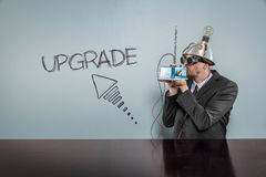 Upgrade text with vintage businessman Royalty Free Stock Photo