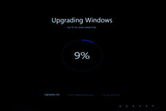 Upgrading windows percentage during the upgrade to Windows 10. PARIS, FRANCE - JAN 7, 2016: Upgrading windows message on computer screen during the upgrade from Stock Images