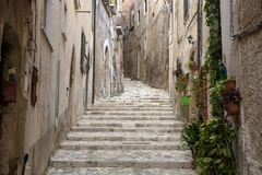 Uphill alley with stairs in Medieval Caiazzo royalty free stock images