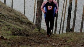 Uphill athlete runner. Ekaterinburg, Russia -  April 24, 2016: slow motion uphill athlete runner during Mountain marathon stock footage