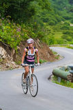 Uphill on a bicycle Stock Photos