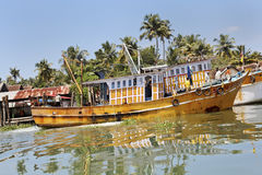 Uphill climb yellow Kerala fishing boat Royalty Free Stock Image
