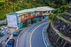 Uphill curve road in a small town stock images