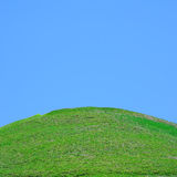 Uphill grass field Royalty Free Stock Photos