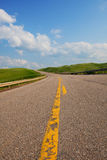 Uphill Highway. A rural, single lane highway winding uphill. Canadian landscape stock photos