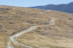 Uphill Road. A trail winds up a hill stock photography