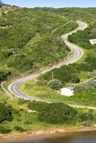Uphill Road. A road winding up a steep hill stock photos