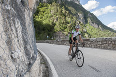 Uphill road cycling woman Stock Photo