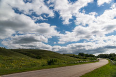 Uphill road. Road goes up the hill against the sky with Royalty Free Stock Image