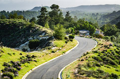 Uphill Road - Orange County, California. Steep and winding asphalt road amidst spring blooms on hills, canyons, and mountains in Orange County, California stock photos