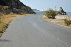 Uphill Road by the Sea Stock Images