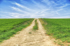 Uphill rural road Royalty Free Stock Photos