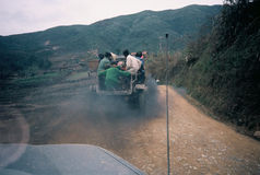 Uphill smokescreen. Homemade truck with passengers lays down a diesel smokescreen, spewing exhaust, in northern Vietnam Stock Images