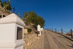 Uphill via crucis. Uphill street with several via crucis stations Stock Images