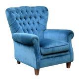 Upholstered blue velvet armchair Royalty Free Stock Photos