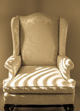 Upholstered Chair in Corner Royalty Free Stock Images