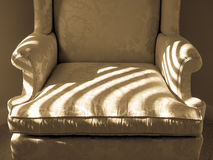 Upholstered Chair with Sunlight Stripes Stock Image