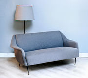 Upholstered fabric grey fifties sofa Royalty Free Stock Image
