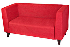 Upholstered 2 seater sofa in red fabric with wooden legs. Red fabric 2 seater sofa, isolated on white, clipping path saved royalty free stock photography