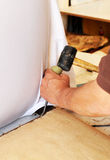 Upholsterer eliminating old staples with tools Stock Photos