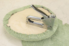 Upholstering a part of chair by staple gun Royalty Free Stock Photography