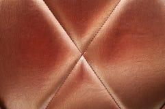 upholstery för bakgrundsbronsläder Fotografering för Bildbyråer