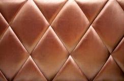 upholstery för bakgrundsbronsläder Royaltyfri Fotografi