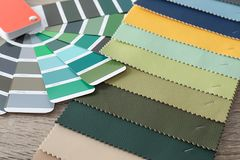 Upholstery fabric samples and color palette. On table. Interior design stock photos