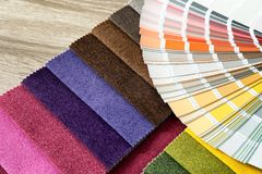 Upholstery fabric samples and color palette. On table. Interior design stock images