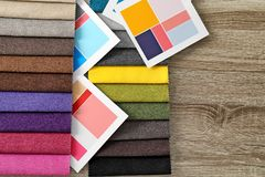 Upholstery fabric samples and color palette. On table. Interior design royalty free stock photo