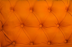 Upholstery leather  sofa. Upholstery leather orange stylish sofa Stock Photography