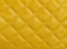 Upholstery leather texture. Yellow color Stock Image