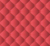 Upholstery Material. Quilted red background with ornaments Stock Photo