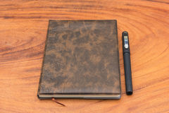 Upholstery Notebook and Pen. On wood background Stock Photos