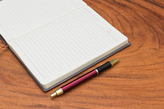 Upholstery Notebook and Pen. On wood background Royalty Free Stock Image