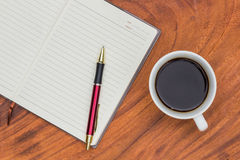 Upholstery Notebook and Pen with coffee. On wood background Royalty Free Stock Photo