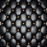 Upholstery pattern. Black leather upholstery with gold buttons , 3d illustration Stock Photography