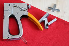 Upholstery stapler. And its application stock photos