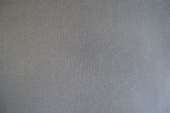 Upholstery texture - simple unprinted grey fabric surface. Upholstery texture - simple unprinted gray fabric surface Royalty Free Stock Photo