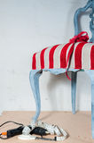 Upholstery work. Wooden chair painted with beautiful fabric Stock Photos