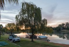 Sunrise at Sakkie se Arkie in Upington. UPINGTON, SOUTH AFRICA - JUNE 12, 2017: Sunrise at Sakkie se Arkie, a holiday resort next to the Orange River at Upington stock photography