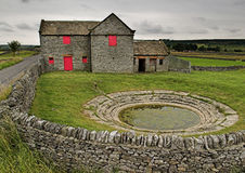 Upland Farm with Dew-pond. English Upland Farm with Dew-pond and red shutters Royalty Free Stock Photo