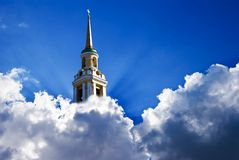 Uplifted christian church. In a dense clouds Royalty Free Stock Photos