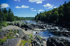 Uplifted Rocks in River. Rocks tilted by natural forces in a river Royalty Free Stock Images