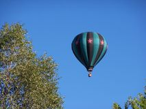 Uplifting Flight. Of HotAir Balloon early morning skies above Winthrop Washington Summer 2013 stock photos